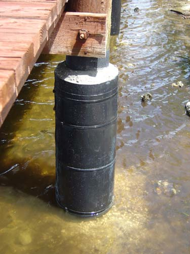 Concrete Piling Repair : All around docks piling reinforcement system